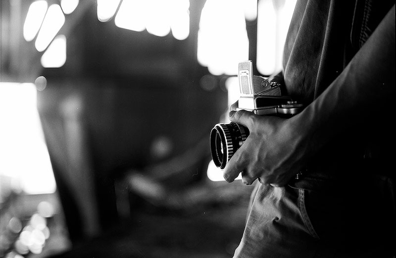 Photograher holding camera